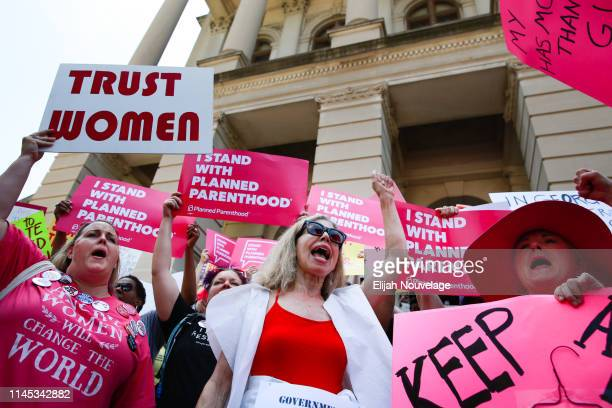 People protest against Georgia's recently passed heartbeat bill at the Georgia State Capitol building on May 21 2019 in Atlanta Georgia The bill...