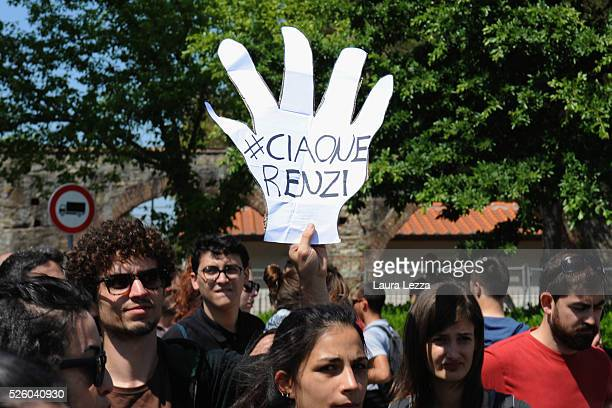 People protest against Italian prime Minister Matteo Renzi with a banner that says 'Ciaone' after the celebration of the anniversary at the CNR of...