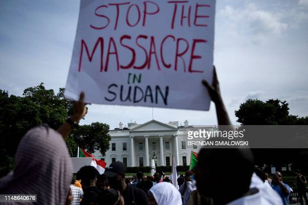 People protest against Monday's deadly military raid on a nonviolent sit-in in Khartoum, Sudan, outside of the White House on June 8, 2019 in...