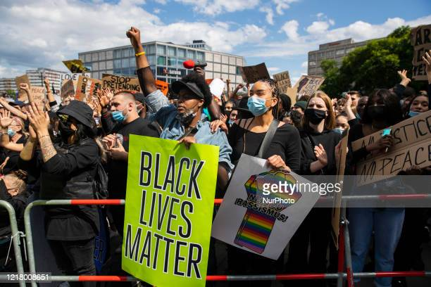 People protest against racism and police brutality and pay tribute to George Floyd in Alexanderplatz in Berlin, Germany on June 06, 2020. About...