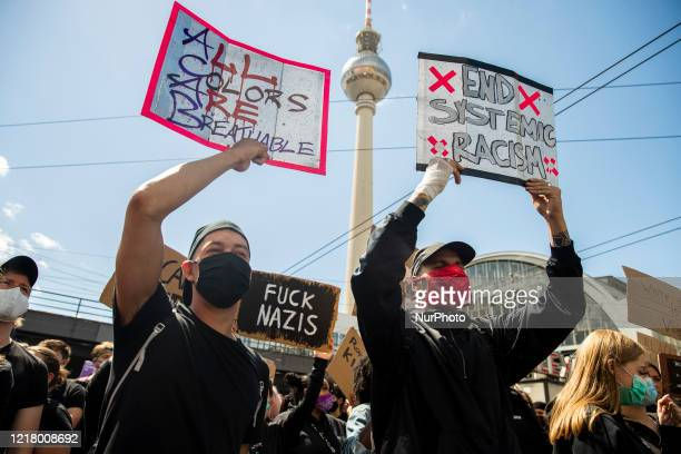 People protest against racism and police brutality and pay tribute to George Floyd in Alexanderplatz in Berlin Germany on June 06 2020 About 15000...