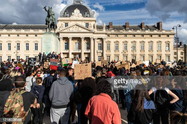 People protest against racism and police brutality in Paris on June 6 as part of 'Black Lives Matter' worldwide protests against racism and police...