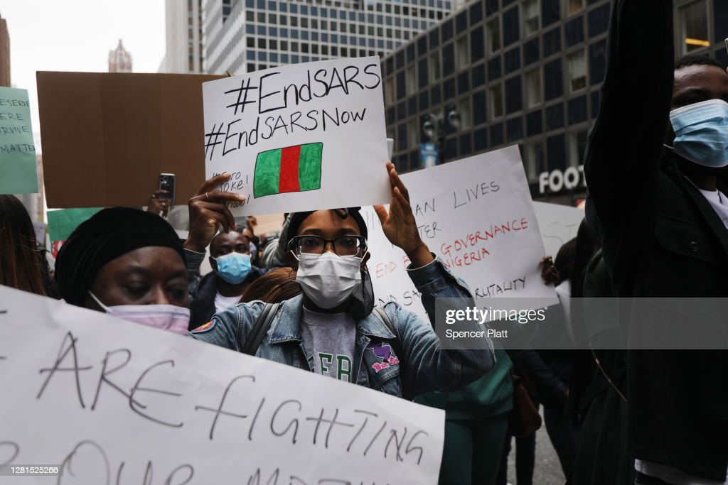 Protestors In New York City Rally Against Police Violence In Nigeria : News Photo