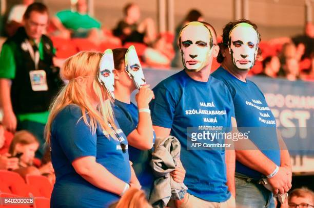 People protest against Russian President Vladimir Putin during the World Judo Championships in Budapest on August 28 2017 / AFP PHOTO / Attila...