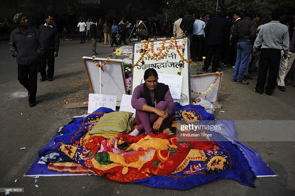 People protest against the alleged inaction by the Indian government regarding the gang rape of a 23-years old student in a bus a month ago, on January 16, 2013 in New Delhi, India. The bus rape has drawn protests and intense media attention. Rapes have become front-page news nearly every day across the country, with demands that police do more to protect women and that the courts treat sexual violence seriously.