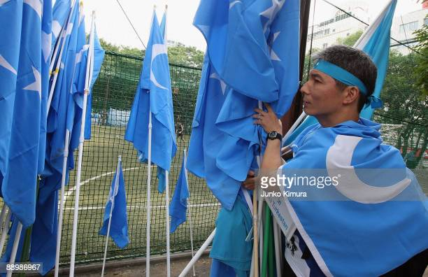 People protest against the Chinese government's treatment on recent ethical clashes in Urumqi at Miyashita Park on July 12 2009 in Tokyo Japan Ethnic...