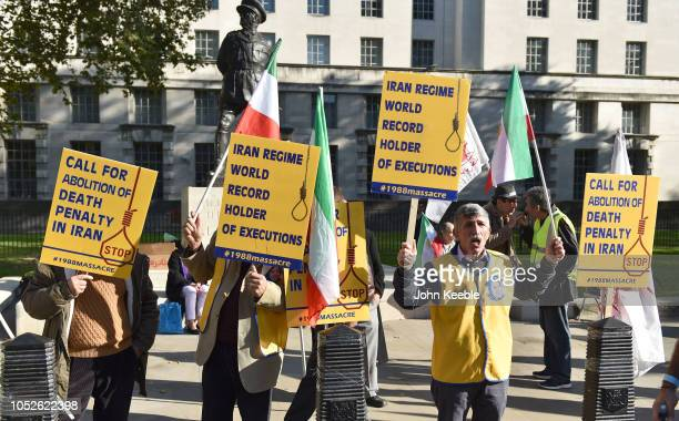 People protest against the death penalty in Iran opposite Downing Street as a march to demand a people's vote against Brexit passes by on October 20...