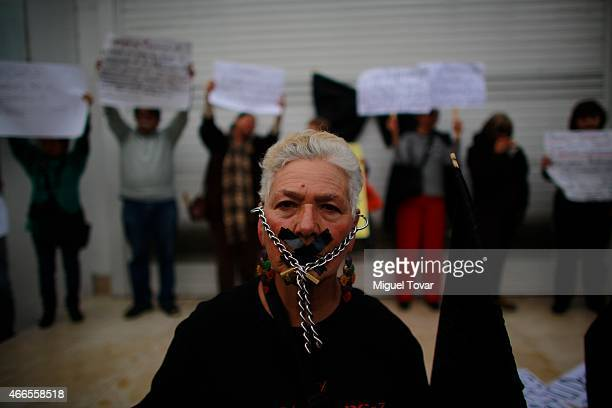 People protest against the dismissal of Mexican journalist Carmen Aristegui from MVS radio on March 16 2015 in Mexico City Mexico Aristeguis...