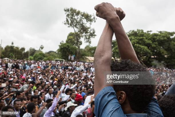 People protest against the Ethiopian government during Irreecha the annual Oromo festival to celebrates the end of the rainy season in Bishoftu on...