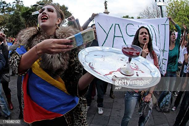 People protest against the exploitation of oil in the Yasuni National Park an incredibly biodiverse part of Ecuador's Amazon in front of the...