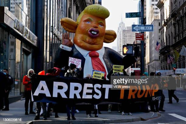 People protest against the former U.S. President Donald Trump at Trump Tower on March 08, 2021 in New York. Trump is returning to New York for the...