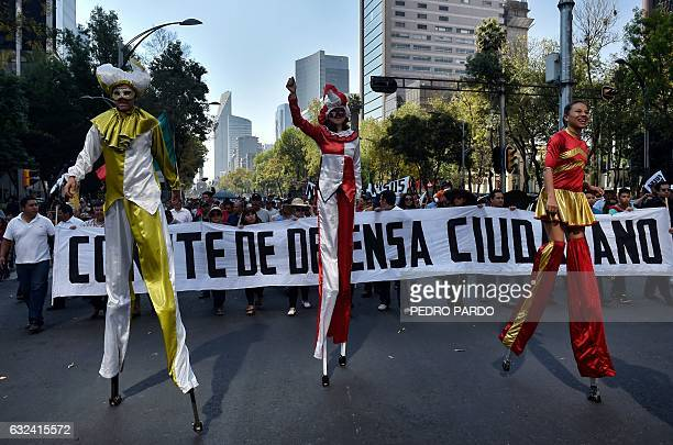 People protest against the fuel price hikes and demand the resignation of Mexican President Enrique Pena Nieto in Mexico City on January 22 2017 A...