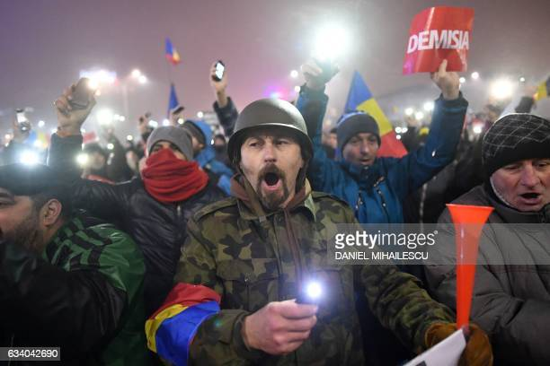 People protest against the government in Bucharest on February 6, 2017. Romania's government formally repealed Sunday contentious corruption...