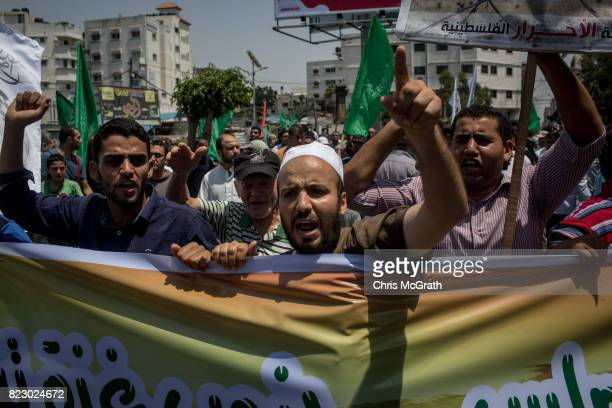 People protest against the installation of metal detectors at Jerusalems AlAqsa mosque by Israeli forces on July 21 2017 in Gaza City Gaza For the...