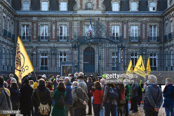 People protest against the installation of the US giant Amazon multinational technology company in front of the Haut-Rhin prefecture in Colmar,...