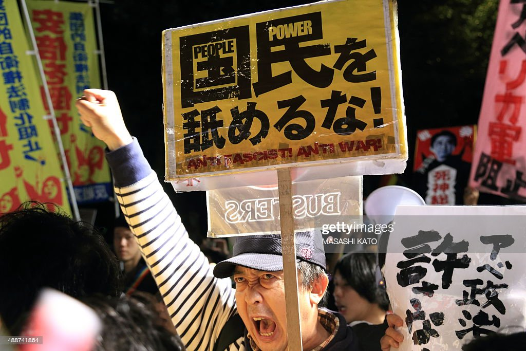 People protest against the new Japan Security Bill on September 17, 2015 in Tokyo, Japan. Hundreds of people gathered to protest against the security bills to expand the roles of Japan Self Defense Force. The scheduled committee vote, which is the second to last vote before the law officially being passed, has been repeatedly delayed by the opposition party. The ruling coalition party lawmakers are aiming to pass the legislation before the end of week.