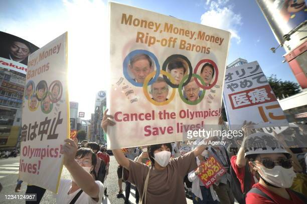 People protest against the Opening ceremony of 2020 Tokyo Summer Olympic Games on July 23, 2020 in Tokyo, Japan, as they ask for the cancel of the...