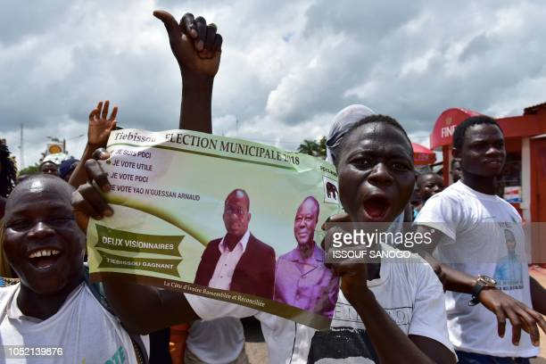 TOPSHOT People protest against the results of Ivory Coast's regional and municipal elections in Tiebissou on October 14 a day after the vote More...