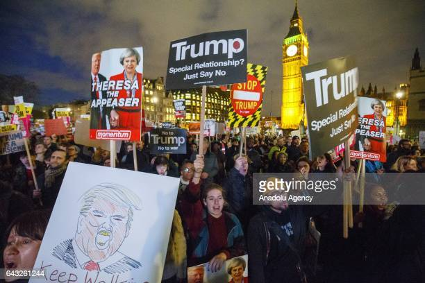 People protest against the US President Donald Trump and demand his planned state visit to the UK to be cancelled in Parliament Square London England...