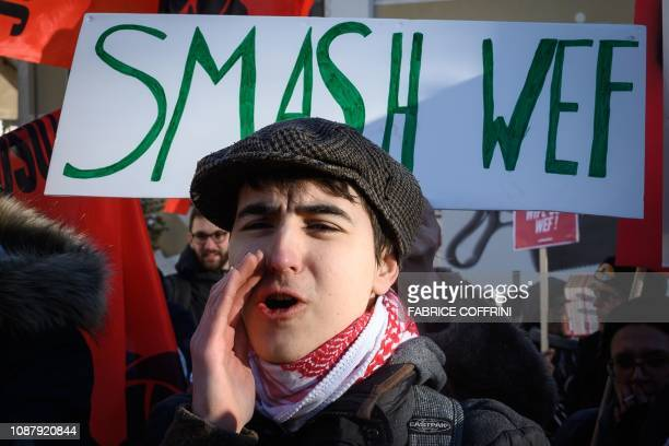 People protest against the World Economic Forum annual meeting during a demonstration on January 24 2019 in Davos eastern Switzerland