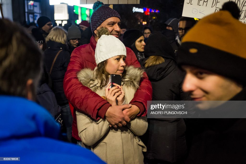 People protest against their government in Bucharest on February 5, 2017. Romania's government formally repealed contentious corruption legislation that has sparked the biggest protests since the fall of dictator Nicolae Ceausescu in 1989, ministerial sources said. The emergency decree, announced on Tuesday (January 31, 2017), would have decriminalised certain corruption offences, raising concerns in Romania and outside that the government was easing up on fighting graft. Centre-right President Klaus Iohannis, elected in 2014 on an anti-graft platform, previously had called the decree 'scandalous' and moved to invoke the constitutional court. / AFP / ANDREI
