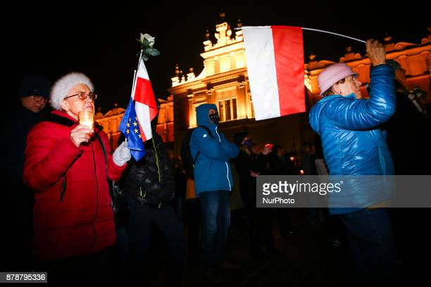 People protest at the Main Square against government plans for sweeping changes to Polands judicial system Krakow Poland on 24 November 2017