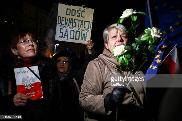 People protest at the Main Square to support Polish judges and demonstrate against governmental restrictive judiciary reforms. Krakow, Poland on...