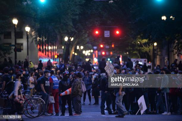 People protest during a demonstration in front of the Multnomah County Justice Center in Portland Oregon on July 17 2020 Rights activists and...