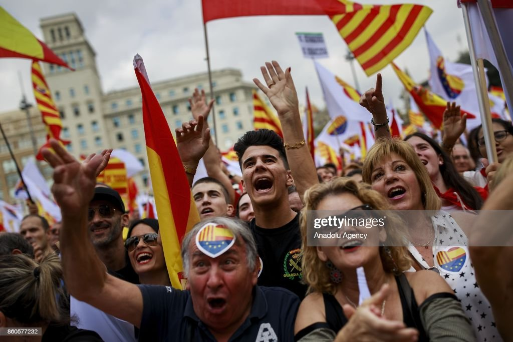 People protest during a demonstration supporting Spain unity at Catalonia square on October 12, 2017 in Barcelona, Spain. Spain celebrates its national day as northeastern region of Catalonia faces a crisis due to an independence declaration.