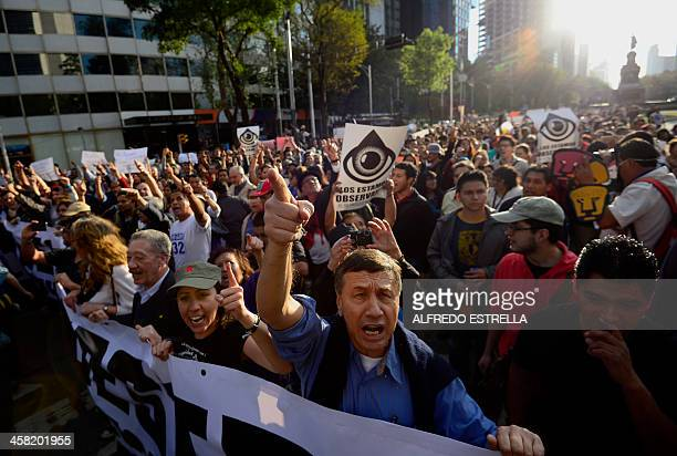 People protest during a rally against the privatization of the stateowned oil company Petroleos Mexicanos on Reforma Avenue in Mexico City on...
