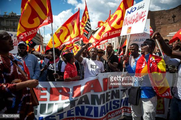 People protest during an antiracist demonstration against economic inequalities and the decision of Italian Interior Minister Matteo Salvini to close...