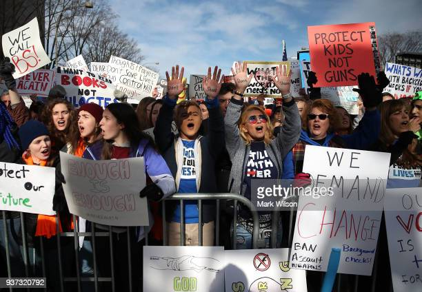 People protest during the March for Our Lives rally on March 24 2018 in Washington DC More than 800 March for Our Lives events organized by survivors...