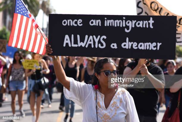 People protest efforts by the Trump administration to phase out DACA which provides protection from deportation for young immigrants brought into the...
