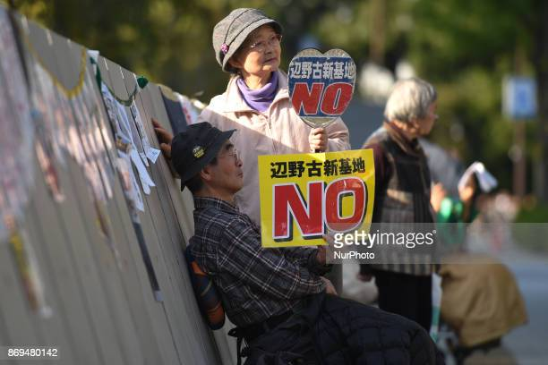 People protest for over 4800 days in front of the parliament building in Tokyo against US military bases in Okinawa just two days ahead of US...