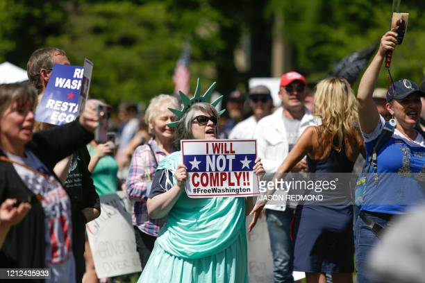 People protest Governor Jay Inslee's stayathome order outside the State Capitol in Olympia Washington on May 9 2020 The Washington State Patrol...