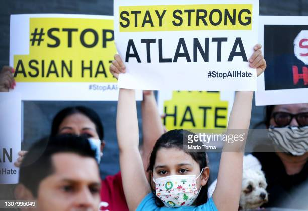 People protest hate crimes committed against Asian-American and Pacific Islander communities ahead of a car caravan in Koreatown on March 19, 2021 in...