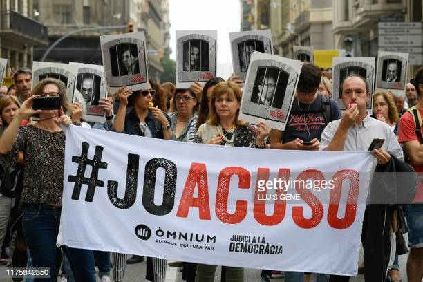 "People protest holding a banner reading ""I accuse"" in Barcelona on October 14 after Spain's Supreme Court sentenced nine Catalan leaders to prison..."