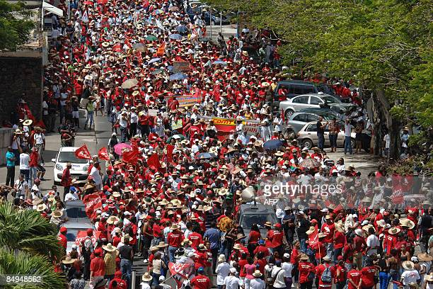 People protest in FortdeFrance on the French Caribbean island of Martinique on February 20 against the high cost of living Unions launched a strike...
