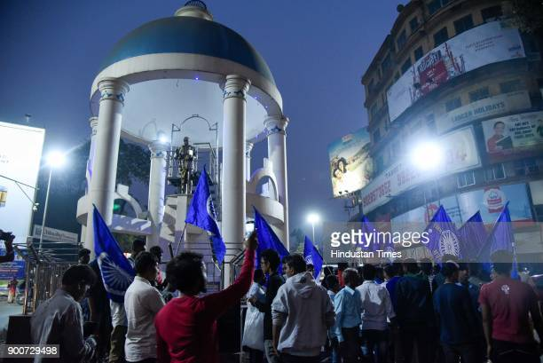 People protest in front of Babasaheb Ambedkar statue on MG road after the clashes between Dalit groups and supporters of rightwing Hindutva...