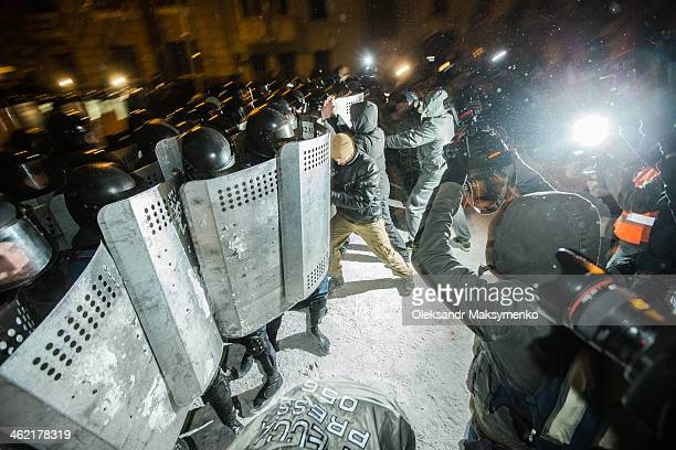 CONTENT] People protest in front of barricades at Independence Square on December 2013 in Kiev Ukraine Mass protest actions started after the...