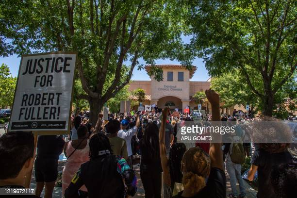 People protest in front of Palmdale Sheriffs Station on June 13 2020 to demand a full investigation into the death of Robert Fuller a 24yearold black...
