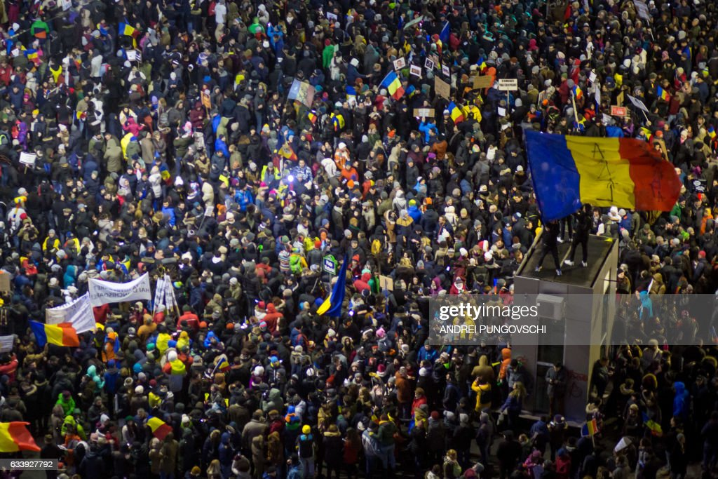 People protest in front of the government headquarters against the government's contentious corruption decree in Bucharest, Romania on February 5, 2017. Romania's government formally repealed contentious corruption legislation that has sparked the biggest protests since the fall of dictator Nicolae Ceausescu in 1989, ministerial sources said. The emergency decree, announced on Tuesday (January 31, 2017), would have decriminalised certain corruption offences, raising concerns in Romania and outside that the government was easing up on fighting graft. Centre-right President Klaus Iohannis, elected in 2014 on an anti-graft platform, previously had called the decree 'scandalous' and moved to invoke the constitutional court. / AFP / ANDREI