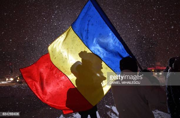 People protest in front of the government headquarters in Bucharest during a protest against controversial corruption decrees on February 8 2017...