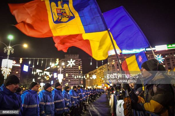 People protest in front of the Romanian Government headquarters in Bucharest on December 10, 2017. Around 7,000 Romanians took to the streets on...