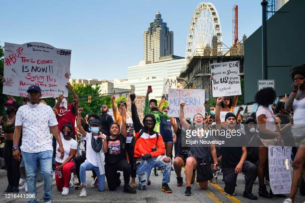 People protest in response to the police killing of George Floyd on May 30 2020 in Atlanta Georgia Across the country protests have erupted following...