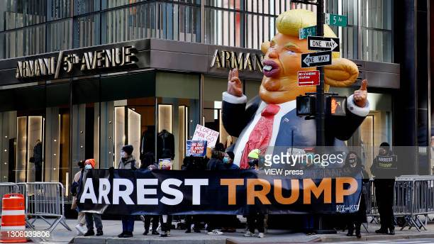 People protest in the sidewalk against the former U.S. President Donald Trump at Trump Tower on March 08, 2021 in New York. Trump is returning to New...