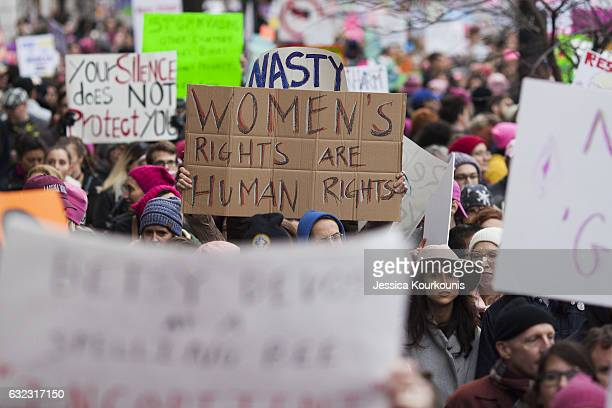 People protest in the streets at the Women's March on Washington on January 21 2017 in Washington DC Following the inauguration of Donald Trump as...