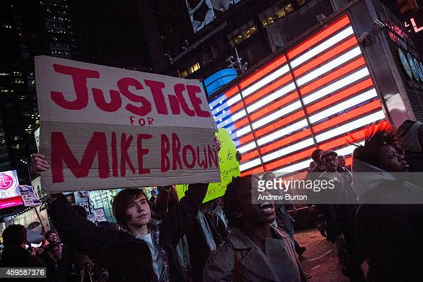 People protest in Times Square over the Ferguson grand jury decision to not indict officer Darren Wilson in the Michael Brown case November 25 2014...