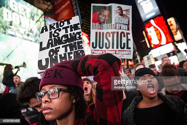 People protest in Times Square over the Ferguson grand jury decision to not indict officer Darren Wilson in the Michael Brown case November 25, 2014...