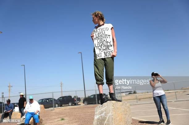 People protest near the tent encampment recently built at the Tornillo-Guadalupe Port of Entry on June 24, 2018 in Tornillo, Texas. The group is...